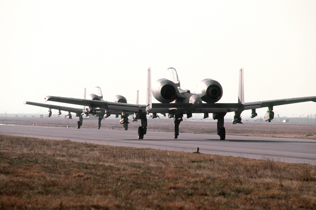 Two A-10 Thunderbolts from the 110th Air National Guard, Battle Creek, Michigan, taxi out onto the runway for a mission