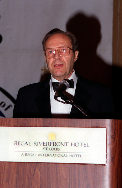 Secretary of Defense, William Perry, speaks at the podium at the Regal Riverfront Hotel during ceremonies commemorating those lost at the Battle of the Bulge 50 years ago