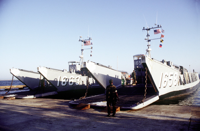 Buses loaded with Cuban voluntary repatriates are loaded onto the Landing Craft, Utility (LCU) for a trip to the air terminal. The return trip home was sponsored by the International Organization for Migration (IOM)