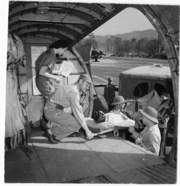 Aircraft airlifting injured serviceman at South Pacific Combat Air Transport Command (SCAT) in the South Pacific during World War II