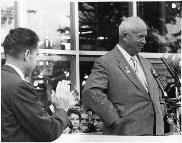 Richard Nixon applauds as Nikita Khrushchev speaks at the American Exhibition in Moscow