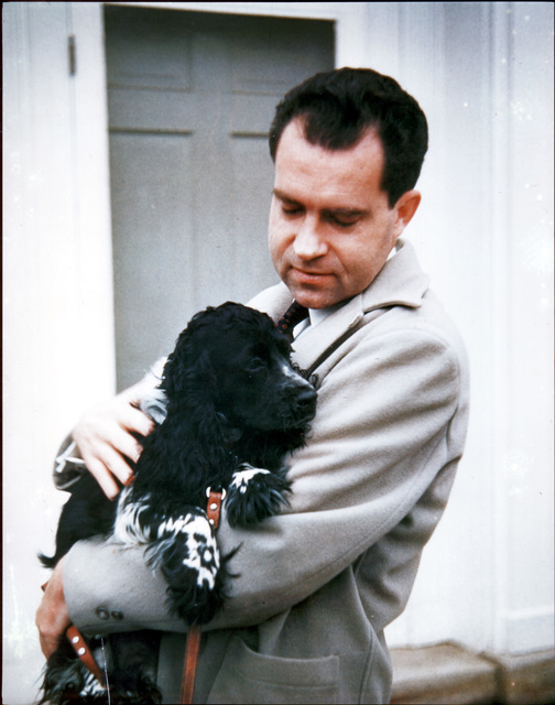Richard Nixon holds his dog Checkers
