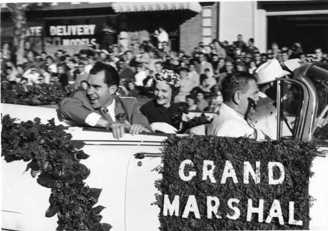 Richard Nixon rides in an automobile with Pat Nixon as Grand Marshall of the Rose Parade in Pasadena, California