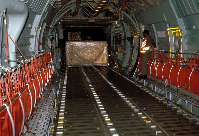 A crate containing a display from the Smithsonian Institution is loaded onto a US Air Force aircraft. The US Air Force often provides airlift support for Smithsonian exhibits being transported to various locations throughout the world for display