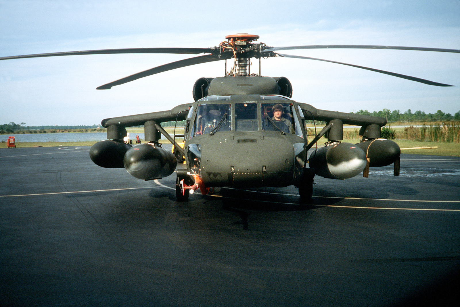 Front view of a UH-60L Black Hawk helicopter armed with