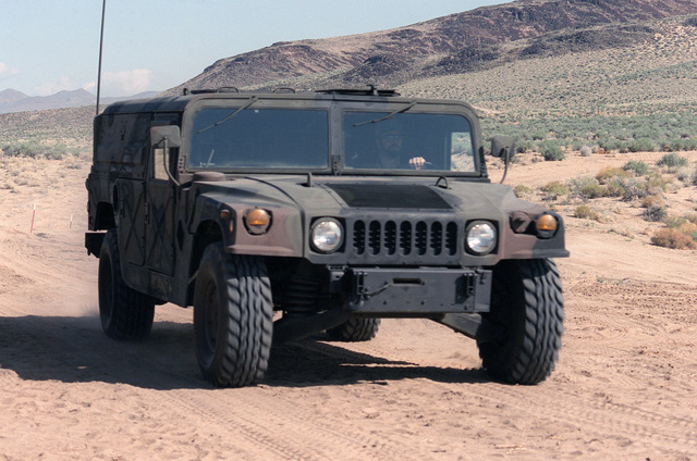 A front view of a US Army M998 High-Mobility Multipurpose Wheeled Vehicle equipped with an M2 .50 caliber machine gun