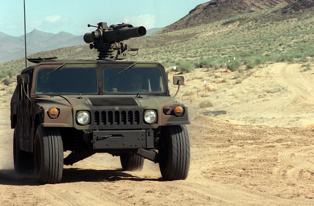 A front view of a U.S. Army M998 High-Mobility Multipurpose Wheeled Vehicle (HMMWV) equipped with an M220A1 tube-launched, optically-tracked, wire-guided (TOW) missile launcher during testing