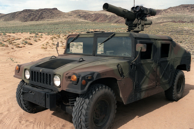 A left front view of a U.S. Army M998 High-Mobility Multipurpose Wheeled Vehicle (HMMWV) equipped with an M220A1 tube-launched, optically-tracked, wire-guided (TOW) missile launcher during testing