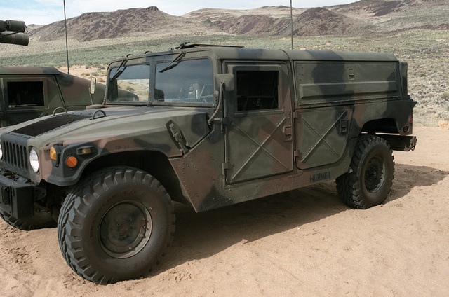 A left front view of a US Army M998 High-Mobility Multipurpose Wheeled Vehicle
