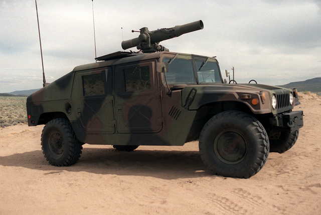 A right front view of a U.S. Army M998 High-Mobility Multipurpose Wheeled Vehicle (HMMWV) equipped with an M220A1 tube-launched, optically-tracked, wire-guided (TOW) missile launcher during testing