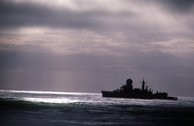 A silhouetted port view of a Tromp class frigate of the Netherlands participating in exercise Ocean Safari '85