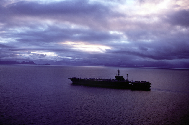 A silhouetted view of the aircraft carrier USS AMERICA (CV-66) underway during exercise Ocean Safari '85