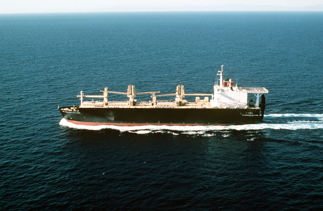 Aerial port beam view of the maritime prepositioning ship USNS PFC Dewayne T. Williams (T-AK 3009) underway