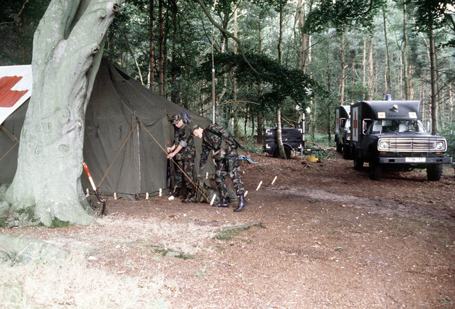 Ambulances arrive at a field medical camp site during exercise Brave Defender '85
