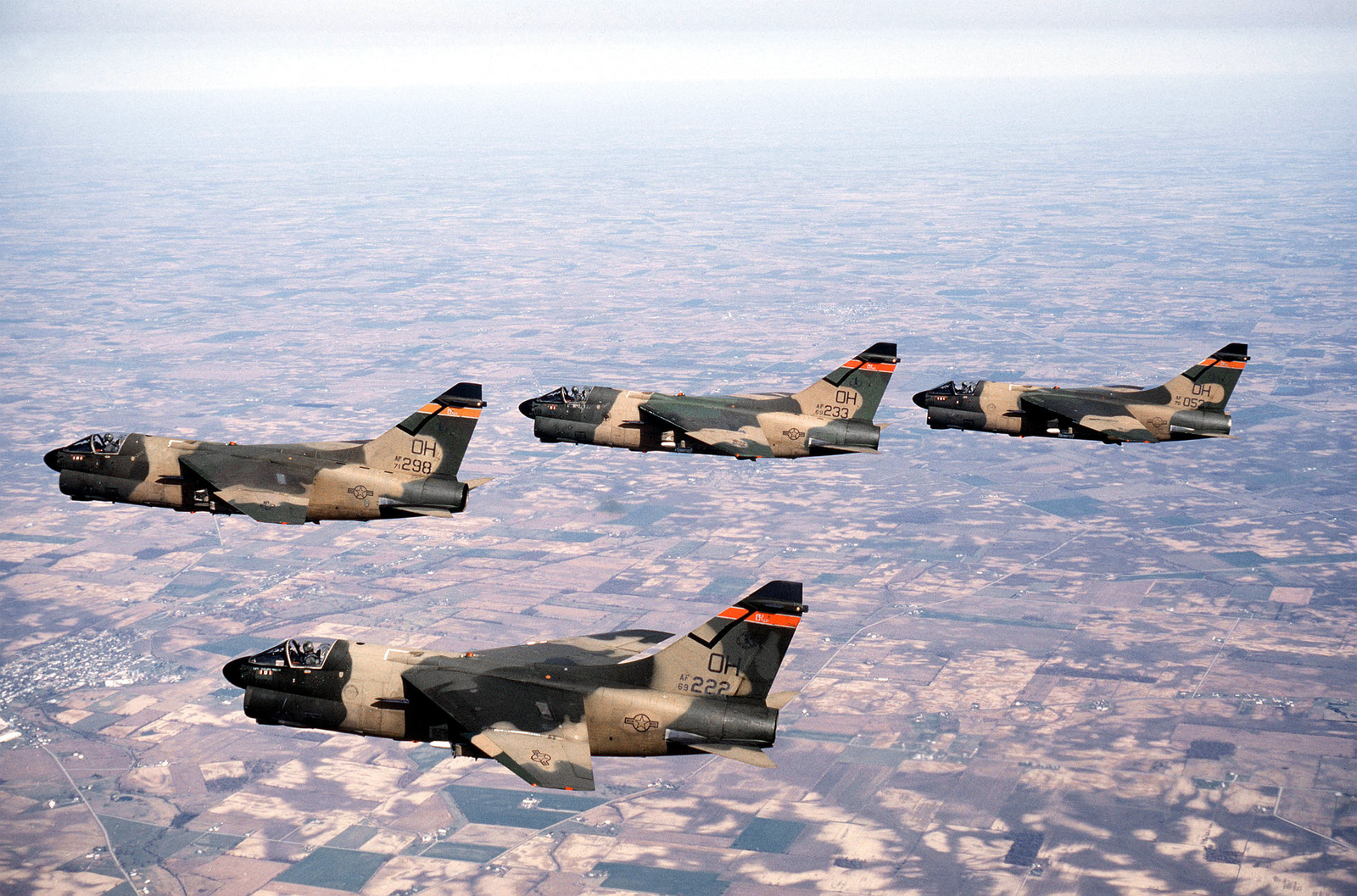 An air-to-air left side view of four A-7D Corsair II aircraft from the 178th Tactical Fighter Group, Ohio Air National Guard