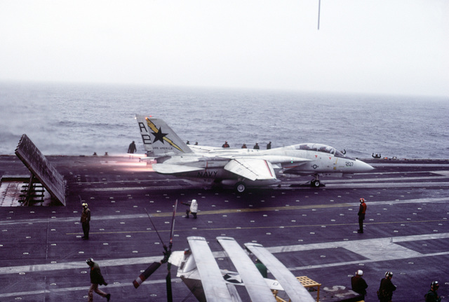 An F-14 Tomcat aircraft is launched from the deck of the aircraft carrier USS AMERICA (CV-66) during exercise Ocean Safari '85