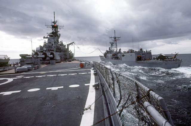 The battleship USS IOWA (BB-61) participates in an underway replenishment with the guided missile frigate USS STEPHEN W. GROVES (FFG-29) during exercise Ocean Safari '85