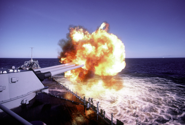 The No. 1 turret Mark 7 16-inch/50-caliber guns are fired aboard the battleship USS IOWA (BB-61) during exercise Ocean Safari '85