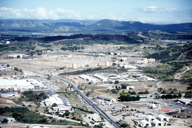 An aerial view of Naval Base Guantanamo Bay's windward side, looking northeast, showing the Navy Exchange and the Bachelor Enlisted Quarters (BEQ) area