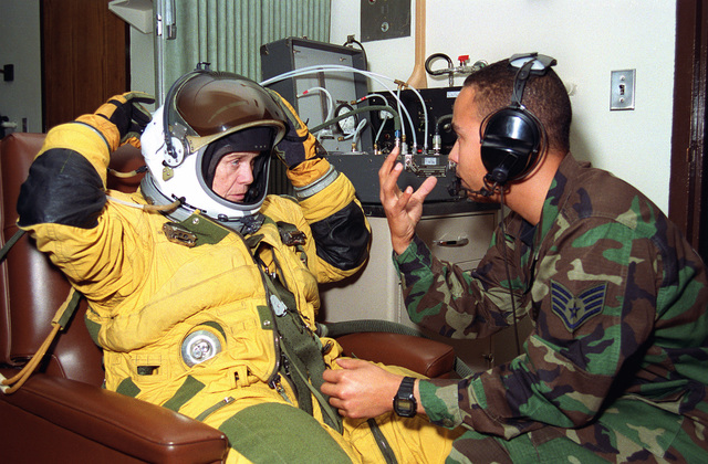 Secretary of the Air Force Sheila Widnall is suited up prior to her U-2 Dragonlady flight. STAFF SGT. Andrew McLean, an aerospace physiologist specialist, integrates the full pressure suit