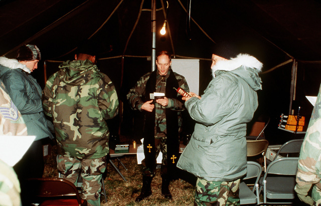 """CAPT Shyack gives a """"war time"""" worship service to troops from the 11th Civil Engineer Squadron, Bolling Air Force Base, Washington, DC during their field training exercise"""