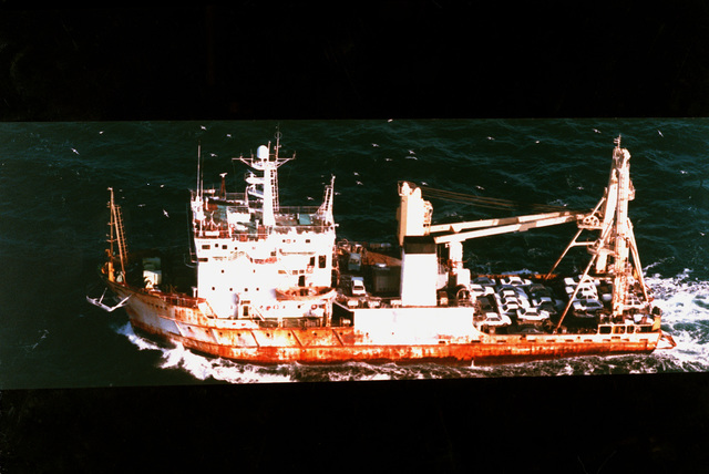 Aerial port side view of the Russian research ship TRIAS carrying a cargo of 25 passenger vehicles