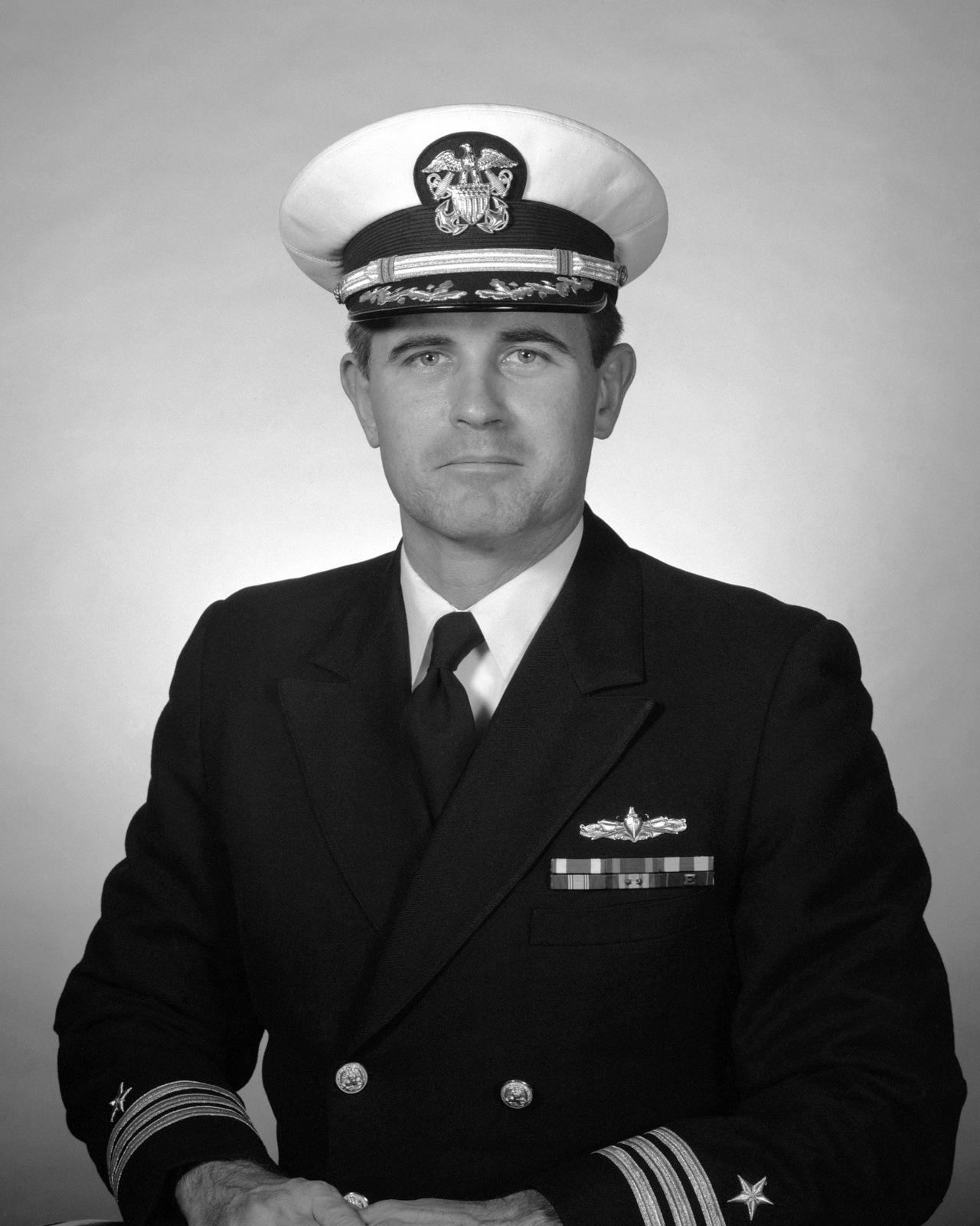 Commander James L. McClane, USN (covered)