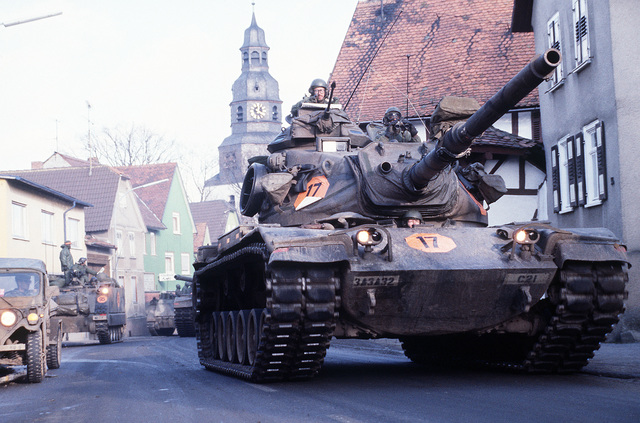 An M-60A3 main battle tank moves along a street during Central Guardian, a phase of Exercise Reforger '85