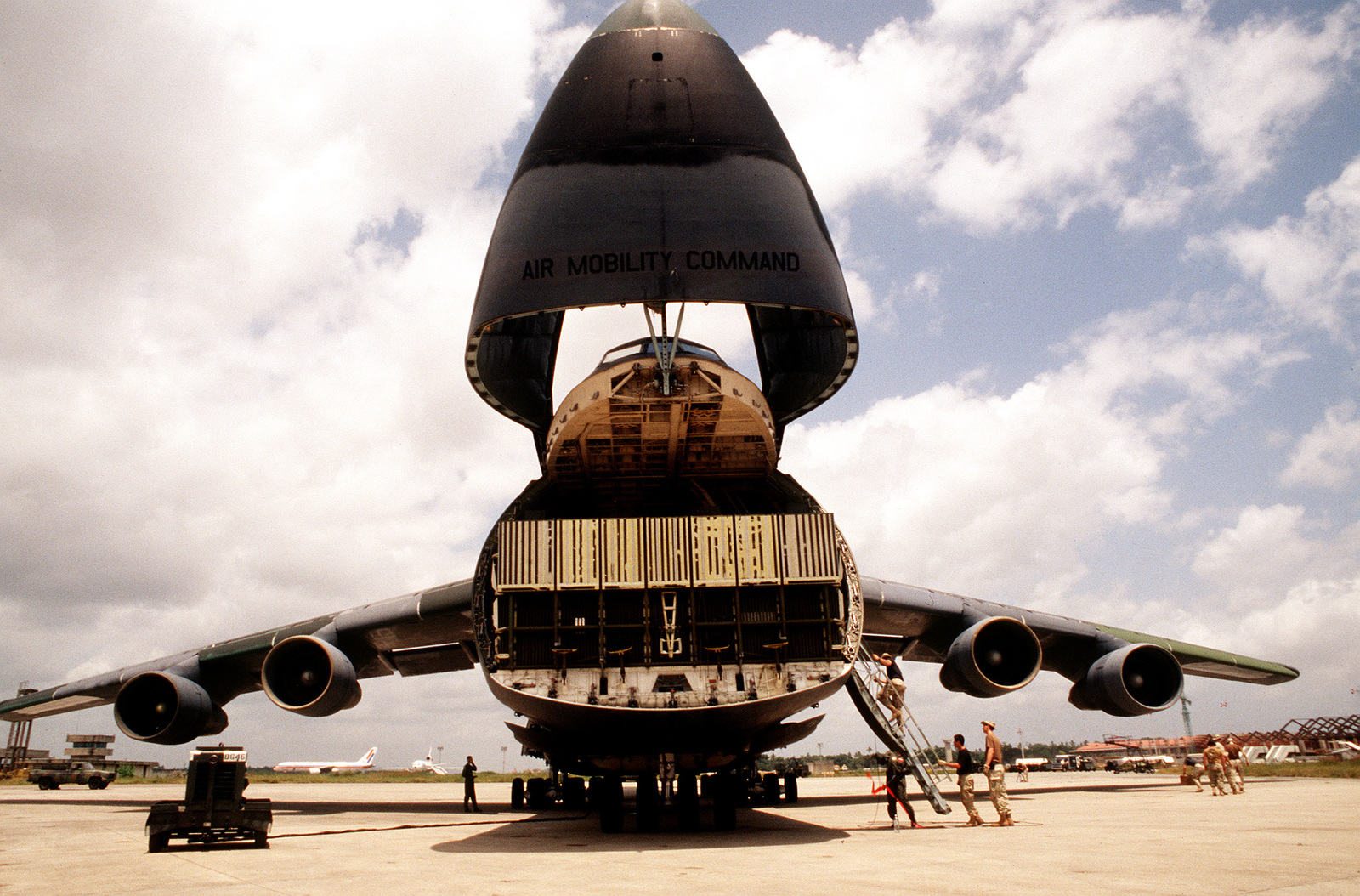 A head on view of a US Air Force C-5 Galaxy from the 3rd Airlift Squadron, Dover Air Force Base, Del., as it prepares to unload its cargo on the ramp of the airport. US Air Force aircraft are bringing in material and equipment to support the withdrawal of United Nations peacekeepers