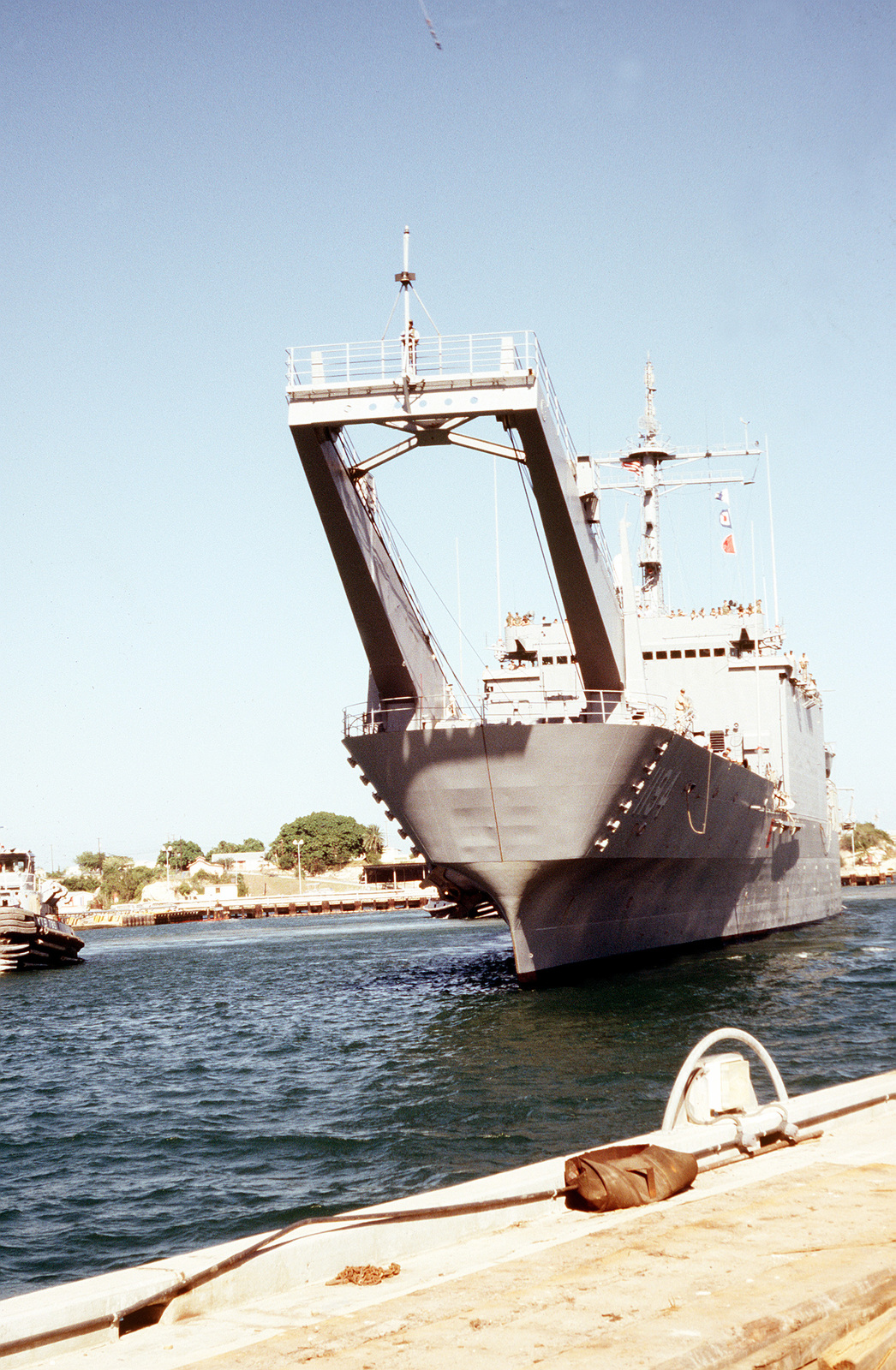 The USS LEMOURE COUNTY (LST-1194) arrives bringing a new Marine Security  Force