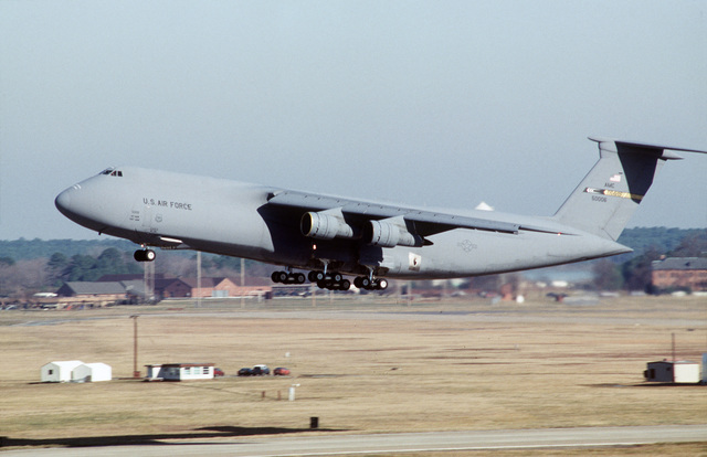 A C-5 Galaxy from Travis Air Force Base, California takes off. This is part of a four day exercise involving Navy, Army, Air Force, Marines and Coast Guard to test proficiency in joint operations and coordination of various elements of a strike package