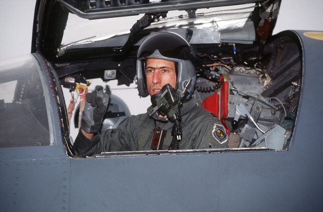 Captain Frank Rossi, a pilot from the 523rd Fighter Squadron, 27th Fighter Wing, Cannon Air Force Base, New Mexico talks from the cockpit of his F-111