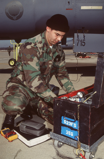 AIRMAN Jesus Navarro, Jr., an electro-environmental specialist from the 523rd Fighter Squadron, Cannon Air Force Base, New Mexico, inspects a tool kit. This is part of a four day exercise involving Navy, Army, Air Force, Marines and Coast Guard to test proficiency in joint operations and coordination of various elements of a strike package