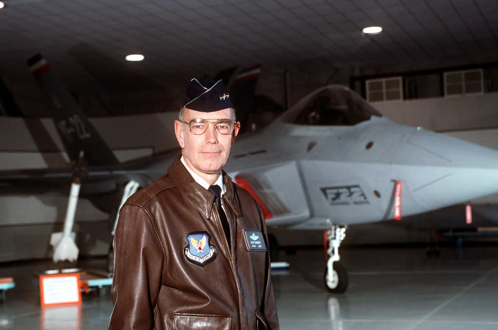 """USAF Lieutenant General Richard Hawley, Principle Deputy to the Air Force's Acquisition Executive poses for a photograph in front of an YF-22 advanced tactical fighter aircraft. From AIRMAN Magazine February 1995 issue article """"Streamlining Acquisition 101"""""""