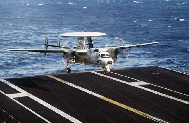 A Navy E-2C Hawkeye, assigned to the USS Theodore Roosevelt (CVN-71) touches down for a landing on the carrier flight deck. This is part of a four day exercise involving Navy, Army, Air Force, Marines and Coast Guard to test proficiency in joint operations and coordination of various elements of a strike package