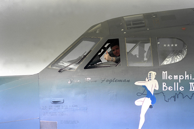 General Ronald Fogelman, Air Force CHIEF of STAFF, gives a thumbs up from the window after piloting a training mission aboard the Memphis Belle IV, the flagship B-52H of Barksdale AFB