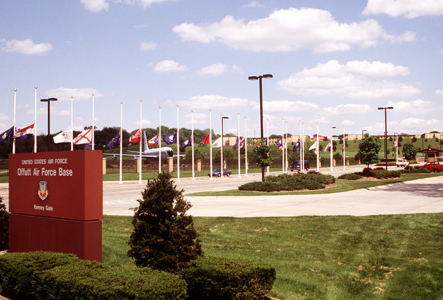 Long-range view of the main gate (Kenny Gate) showing the base sign and the 24 flags.EXACT DATE SHOT UNKNOWN