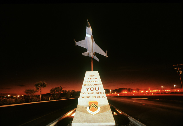 A one fifth scale F-16 sits atop a welcoming pedestal approximately one third mile from the south gate. The pedestal can be tailored to welcome specific groups or individuals to the base