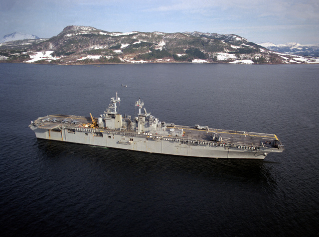 Aerial starboard side view of the amphibious assault ship USS WASP (LHD-1) transiting the Surmadal Fjord at the conclusion of exercise Strong Resolve '95