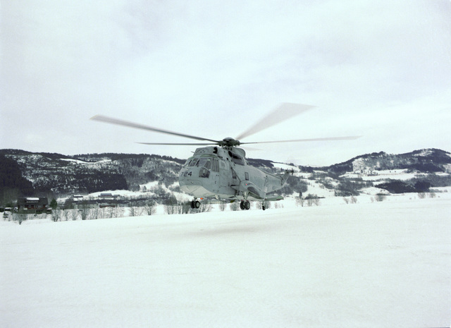 An SH-3 Sea King helicopter of Commander Second Fleet (COMSECONDFLT) is shown taking off from a field in Surnadalsora at the conclusion of exercise Strong Resolve '95. The helo, assigned to Composite Helicopter Squadron Two (HC-2), is attached to the USS MOUNT WHITNEY (LCC-20)