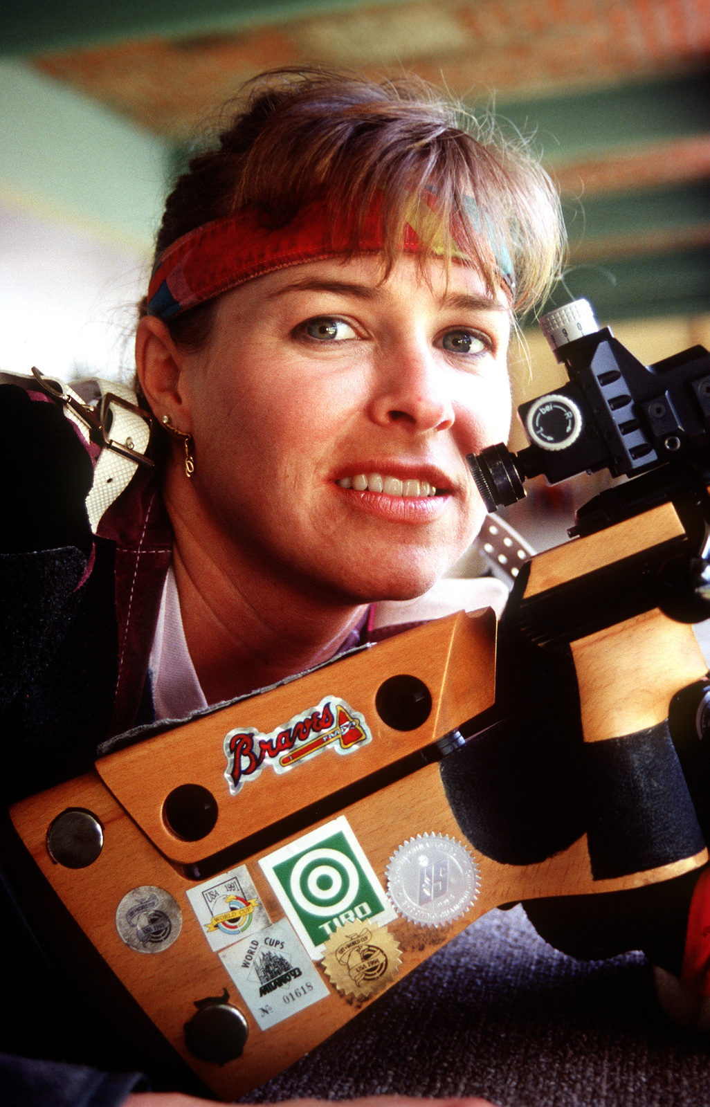 Deena Wigger, US Air National Guardsman, poses with her rifle at the Tiro Federal Argentina complex. Wigger won the Gold Medal in the Women's Standard Rifle 3x20 at the 12th Pan American Games