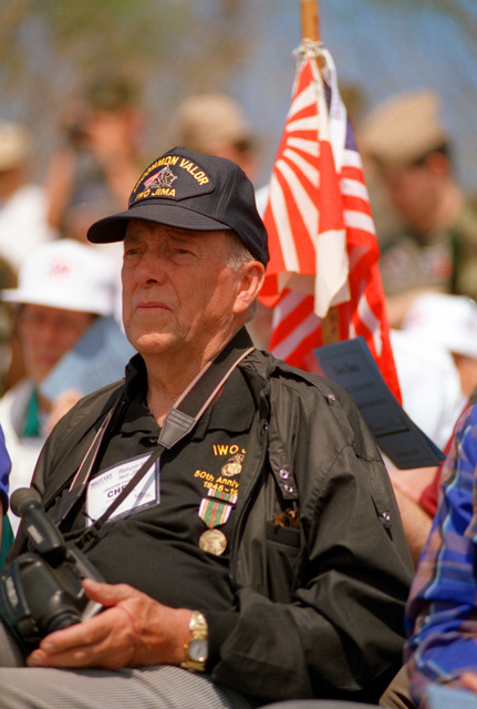 """Chester """"Chet"""" Foluke, a 5th Marine Division veteran and a member of the Iwo Jima Survivor's Association is shown in attendance at the memorial service at the Reunion of Honor Memorial atop Mount Suribachi. The ceremony commemorated the 50th anniversary of the battle for Iwo Jima and was attended by both American and Japanese veterans"""