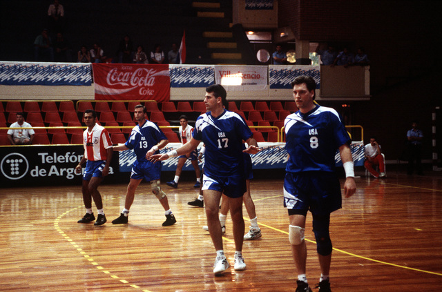 LT. Dave DeGraff plays defense in a team handball game against the Paraguay team at the handball venue at Villa Ballester. The U.S. team easily defeated the Paraguay team 27-13