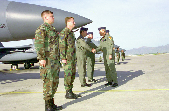 "Brigadier General Stephen B. Plummer, 56th Fighter Wing commander, greets pilots and maintainers from the 550th Fighter Squadron, ""Silver Eagles,"" prior to the departure of the last three F-15E Strike Eagles from Luke Air Force Base, Arizona, enroute to Seymour-Johnson Air Force Base, North Carolina"