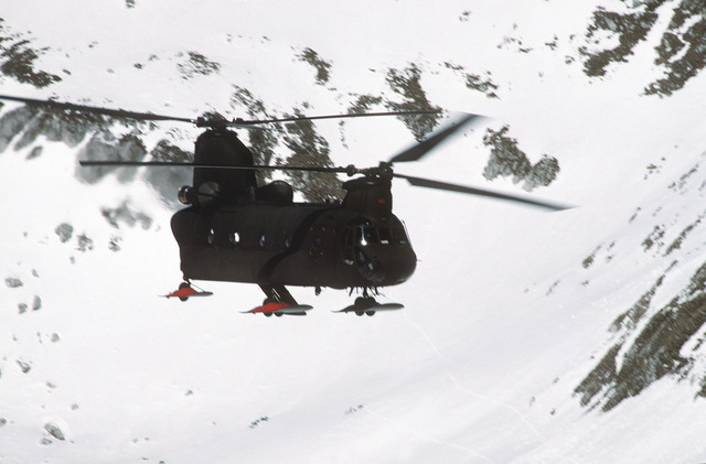 A ski equipped US Army CH-47D Chinook helicopter flies over the Italian Alps. The Army's 502nd Echo Company, Aviation Regiment routinely does mountain training in the Italian Alps near their home station of Aviano Air Base, Italy. The Chinook was outfitted with skis to perform mountain landings in the snow, enhancing the regiment's effectiveness in the mountains