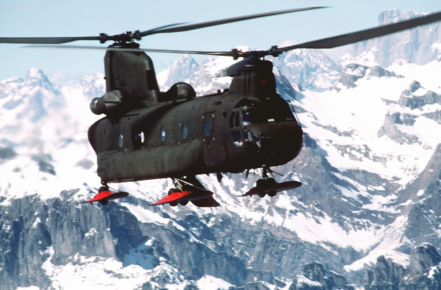 A ski equipped US Army CH-47D Chinook helicopter flies over the Italian Alps. The Army's 502nd Echo Company, Aviation Regiment routinely does mountain training in the Italian Alps, near their home station of Aviano Air Base, Italy. The Chinook was outfitted with skis to perform mountain landings in the snow, enhancing the regiment's effectiveness in the mountains