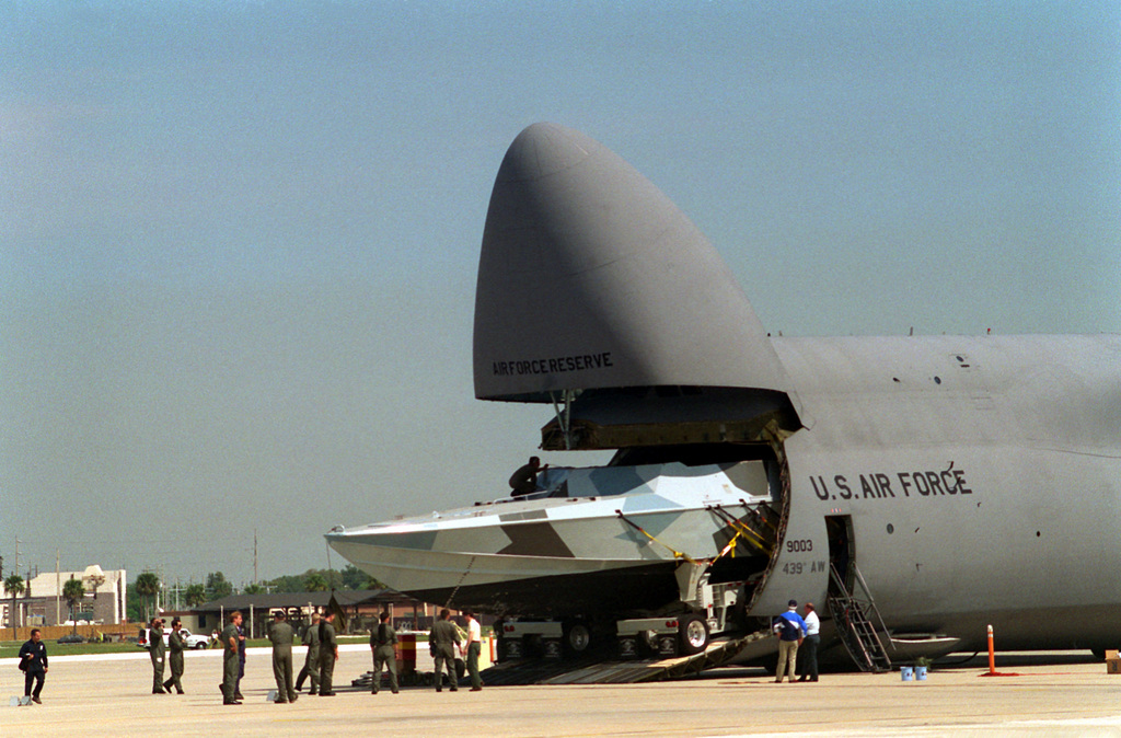 A Halter Marine Mark V combatant craft is offloaded from a USAF C-5A Galaxy of the 439th Air Wing at Naval Air Station Jacksonville. It will undergo testing and evaluation on Tampa Bay. The 57-ton water jet-powered craft has a 5 man crew and can carry 16 SEALS. It has a 50 knot speed and 500 nautical mile range