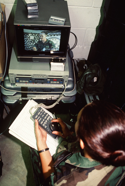 A videographer with the 1ST Combat Camera Squadron, Charleston Air Force Base, S.C., edits a clip to be used by the observer/trainer section during the exercise