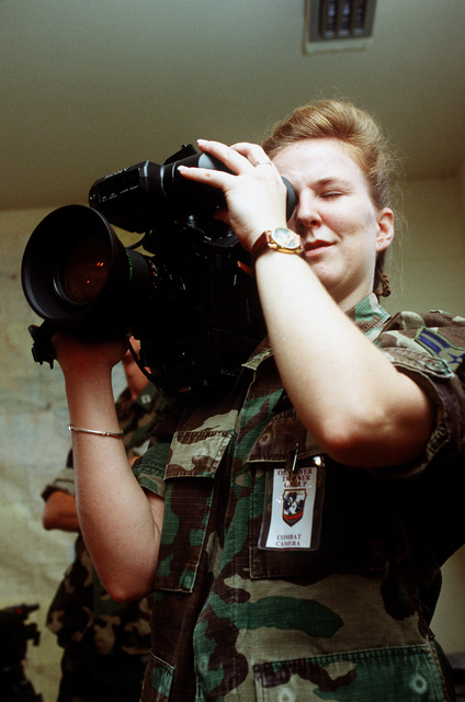 AIRMAN 1ST Class Suzanne Rogers, 1ST Combat Camera Squadron, Charleston Air Force Base, S.C., documents a press conference held in the Joint Information Bureau at the start of the exercise