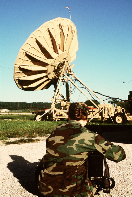 AIRMAN 1ST Class Suzanne Rogers, 1ST Combat Camera Squadron, Charleston Air Force Base, S.C., documents the disassemblying of an AN/TSC-85 Ground Mobile Forces Tactical SHF Satellite Terminal of the Joint Communication Support Element, MacDill Air Force Base, Fla., during the closing hours of the exercise